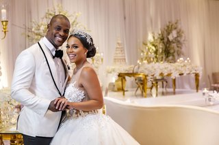happy-bride-and-groom-nfl-player-wedding-tahir-whitehead-oakland-raiders-shannon-perkins-ball-gown