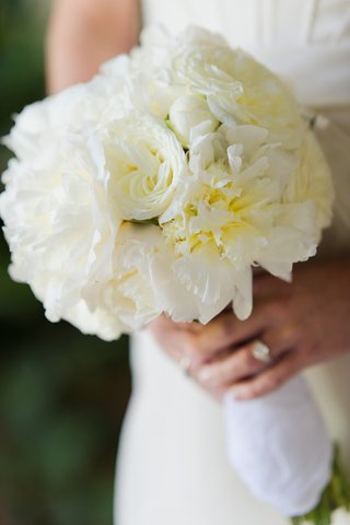 bride-carrying-white-peonies-and-roses