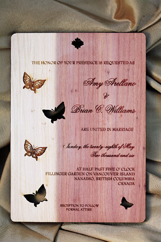 wedding-invitation-made-of-cedar-wood-and-decorated-with-butterflies