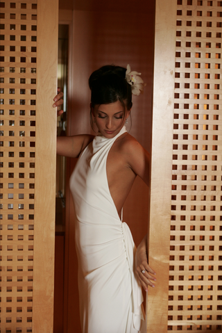 bride-in-high-neck-wedding-dress-with-open-back