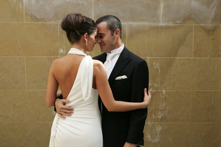 groom-and-bride-in-white-wedding-dress-with-sexy-back