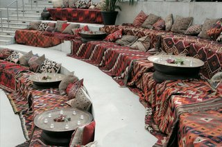 amphitheater-ceremony-seating-covered-with-patterned-blankets-and-pillows