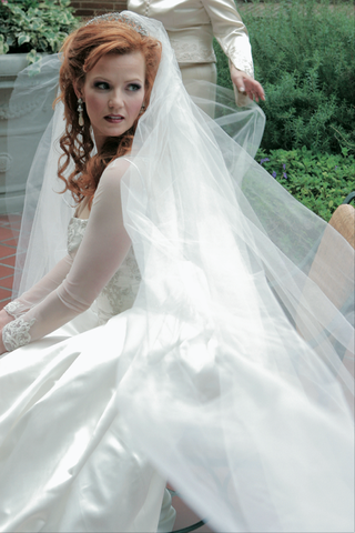 bride-in-classic-dress-with-long-cathedral-veil