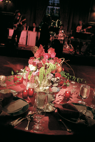 red-table-linens-with-abundant-flower-centerpiece