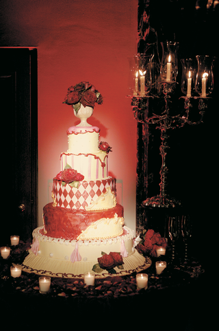 five-layer-red-pink-and-white-cake-with-rose-topper