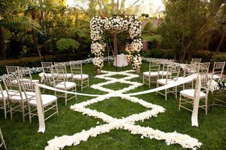 white-flower-chuppah-with-petal-aisleway-on-grass-lawn