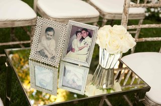 crystal-frames-with-old-family-photos-on-mirror-table