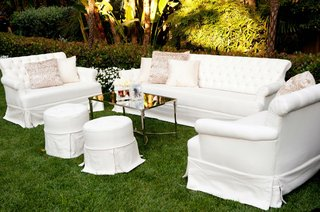 white-sofa-and-settee-on-grass-lawn-at-wedding-ceremony
