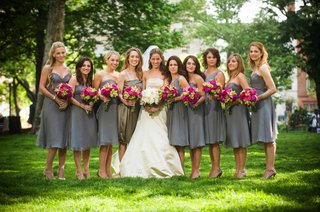 bride-in-a-monique-lhuillier-gown-and-bridesmaids-in-slate-grey-tea-length-dresses