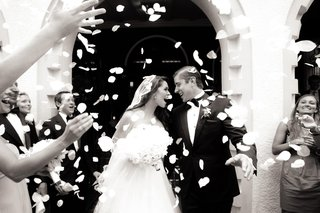 guests-toss-rose-petals-on-newlyweds-exiting-ceremony