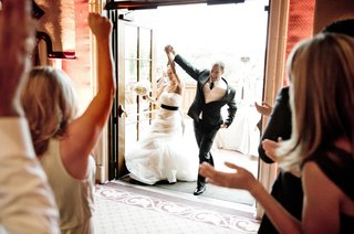 steve-finley-and-bride-happily-walk-through-doors