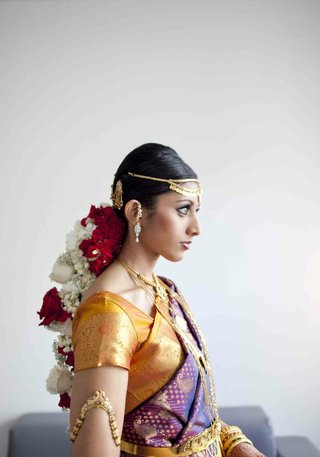 actress-reshma-shetty-wears-a-purple-and-gold-lehenga-flowers-in-her-hair-and-gold-jewelry