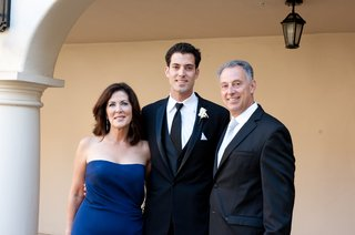 groom-and-father-with-mother-of-bride-in-strapless-gown