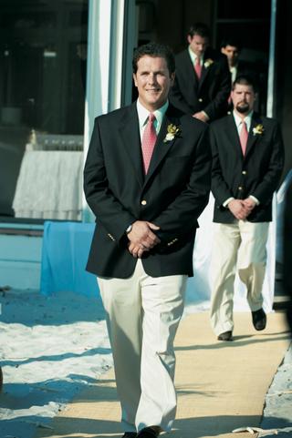 groomsmen-walk-down-aisle-wearing-pink-ties
