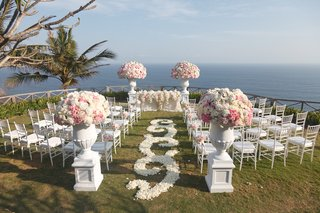 white-rose-petal-swirl-aisle-at-pink-and-white-flower-ceremony