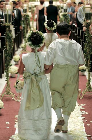 little-boy-and-girl-walk-down-aisle
