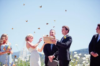 bride-and-groom-holding-box-of-monarch-butterflies