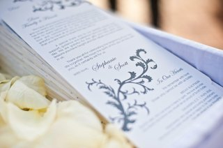 ceremony-booklets-in-white-lined-basket-with-petals
