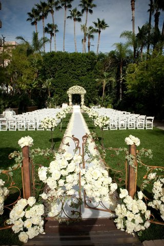 floral-embellished-gate-and-wedding-canopy
