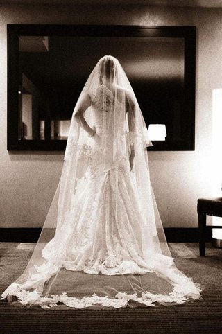 black-and-white-photo-of-bride-looking-in-mirror