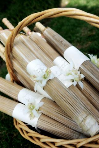 basket-of-wooden-old-fashioned-parasols