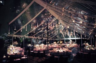 candlelit-dinner-service-under-clear-tent