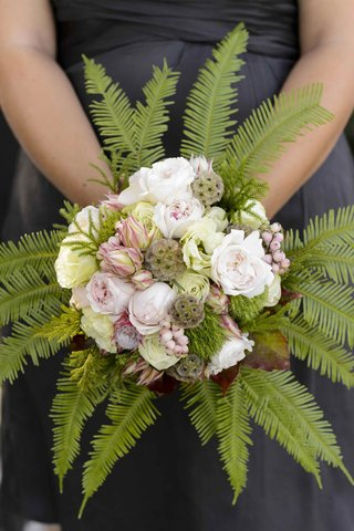 bridesmaid-holding-textured-flowers-with-ferns