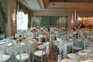 tables-with-blue-green-linens-and-antique-candleholders