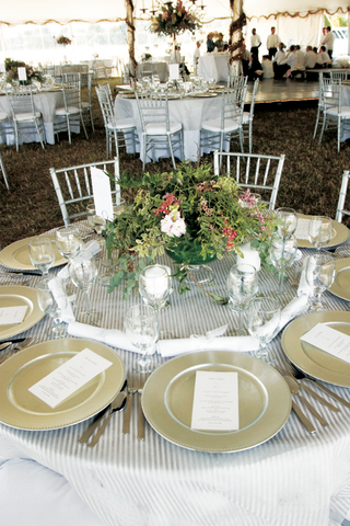 table-on-grass-with-striped-tablecloth-and-natural-centerpiece
