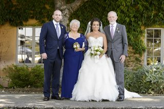 bride-and-groom-with-cowboy-hat-dad-and-sisters