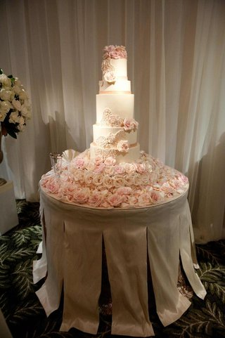 white-seven-layer-cake-with-fresh-pink-flowers