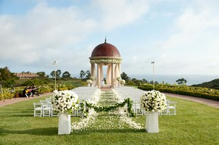 white-chairs-along-petal-aisle-and-rotunda