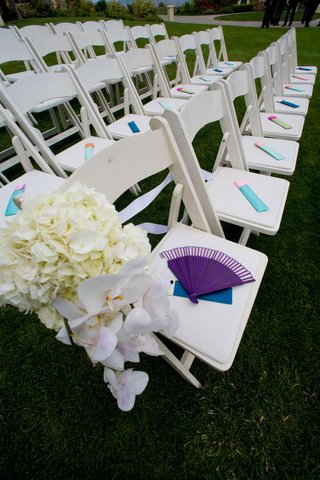 colorful-ceremony-fans-on-white-guest-chairs