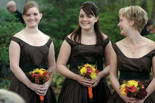 three-bridesmaids-in-brown-dresses-hold-fall-bouquets