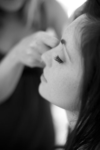black-and-white-photo-of-bride-getting-makeup-done