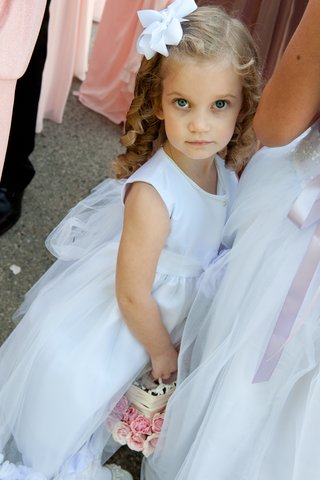 flower-girl-with-pearls-and-white-bow-in-curly-hair