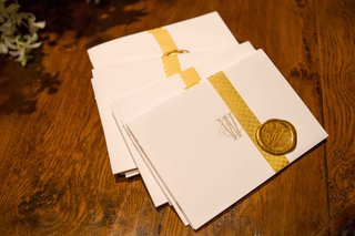 ceremony-program-with-gold-ribbon-and-wax-seal