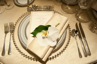 silver-bead-charger-with-china-and-orchid-flower