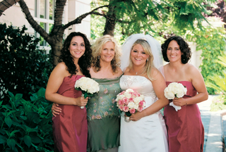 bride-smiles-with-mother-of-bride-and-two-bridesmaids