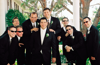 groom-and-groomsmen-in-suits-and-sunglasses