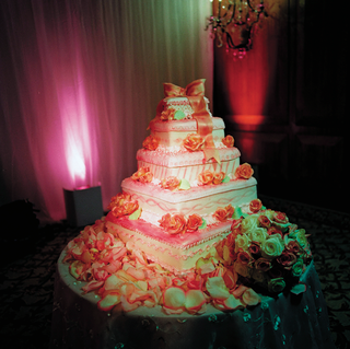 five-layer-wedding-cake-with-pink-bow-cake-topper