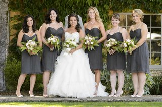 bride-with-bridesmaids-in-short-gray-dresses-and-fern-bouquets