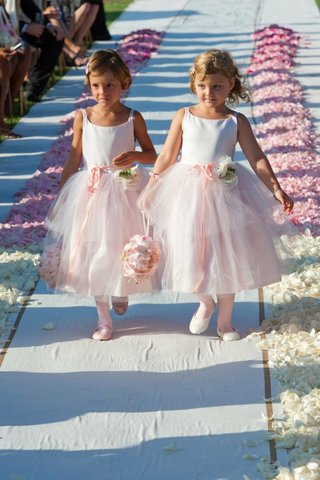 two-flower-girls-walk-down-petal-lined-aisle