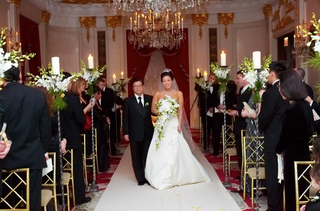 bride-walks-down-aisle-at-ballroom-wedding