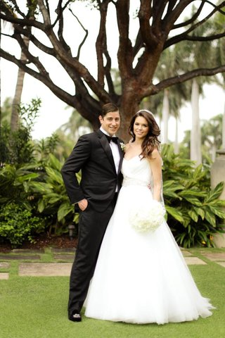 strapless-ball-gown-and-groom-in-black-tuxedo