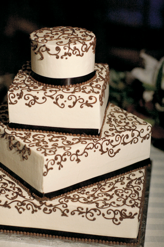 white-four-layer-wedding-cake-with-brown-design