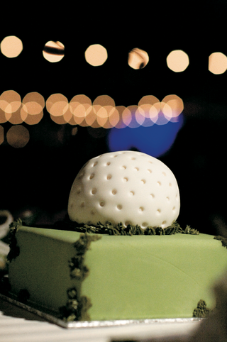 groom-cake-in-shape-of-golf-ball-on-green-lawn