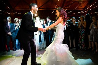 wedding-in-barn-twinkle-lights-bride-in-trumpet-bridal-gown-wedding-dress-first-dance-with-guests