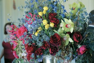 large-floral-arrangement-in-blue-purple-red-yellow-and-green