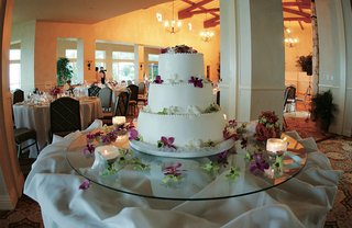 white-round-cake-with-three-tiers-and-flowers